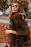 Gorgeous sensual woman with blond hair in luxurious fur coat Royalty Free Stock Photography