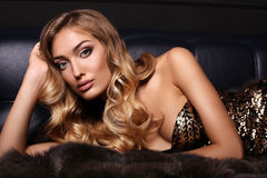 Gorgeous sensual woman with blond hair in luxurious fur coat Royalty Free Stock Photo