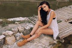 Gorgeous sensual woman with dark hair posing at farm Stock Image