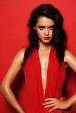Gorgeous sensual woman with dark hair wears elegant red dress Royalty Free Stock Photo