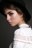 Gorgeous sensual woman with dark straight hair wears elegant dress Stock Photography