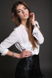 Gorgeous sensual woman with dark straight hair wears elegant dress Stock Image