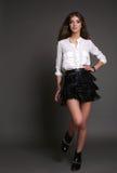 Gorgeous sensual woman with dark straight hair wears elegant dress Stock Photo