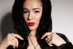Gorgeous sensual woman with elegant hairstyle,wears fur coat Royalty Free Stock Photo