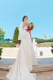 Gorgeous sexy bride in white dress posing on street Royalty Free Stock Photography