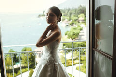 Gorgeous sexy brunette bride posing at balcony at sea resort hot Stock Images