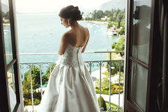 Gorgeous sexy brunette bride posing at balcony at sea resort hot Royalty Free Stock Photo
