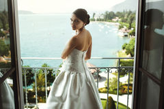 Gorgeous sexy brunette bride posing at balcony at sea resort hot Royalty Free Stock Photos