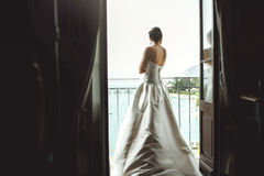 Gorgeous sexy brunette bride posing at balcony at sea resort hot Royalty Free Stock Images