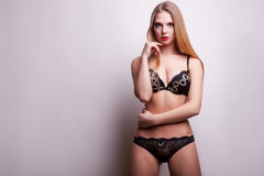 Gorgeous sexy girl in black panties and bra Stock Images