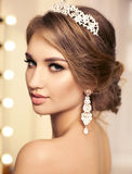 Gorgeous sexy girl with evening makeup and accessories Royalty Free Stock Photography