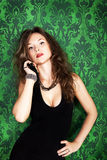Gorgeous sexy girl on green vintage wall background Stock Images