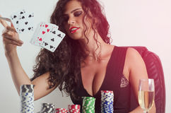 Gorgeous sexy poker girl throwing cards in air Royalty Free Stock Images