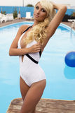 Gorgeous sexy woman with blond hair in elegant swimsuit Stock Images