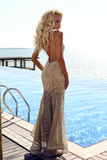 Gorgeous sexy woman with blond hair in luxurious dress Royalty Free Stock Image
