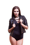 Gorgeous sexy woman in body and leather jacket. Studio photo. Glamour and fashion Royalty Free Stock Photo