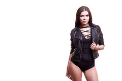Gorgeous sexy woman in body and leather jacket. Studio photo. Glamour and fashion Stock Photography