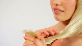 Gorgeous sexy woman showing shiny healthy hair, studio stock video footage