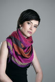 Gorgeous short hair brunette beauty wearing colorful shawl around neck looking at camera Royalty Free Stock Image