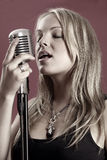 Gorgeous singer and vintage microphone Royalty Free Stock Image