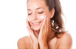 Gorgeous skincare brunette. Portrait of a young gorgeous skincare brunette Stock Photography