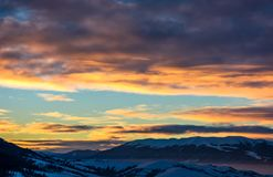 Gorgeous sky on winter sunrise in mountains Stock Photography