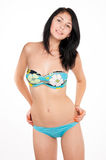 Gorgeous slim brunette in swimsuit Stock Photography