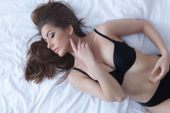 Gorgeous slim girl posing in erotic black lingerie Royalty Free Stock Images