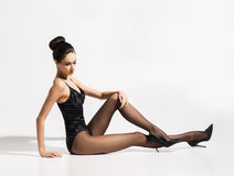 Gorgeous, slim woman posing in alluring underwear and stockings Stock Photo