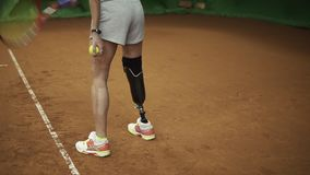 Gorgeous slow motion footage of a stunning tall woman serving the ball. Disabled woman.  stock video footage
