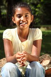 Gorgeous smile in golden sunshine from young girl Royalty Free Stock Photo