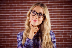 Gorgeous smiling blonde hipster daydreaming Stock Photos