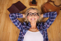 Gorgeous smiling blonde hipster lying Royalty Free Stock Photo