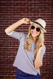 Gorgeous smiling blonde hipster posing with straw hat Stock Photo