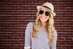 Gorgeous smiling blonde hipster with sunglasses and straw hat Royalty Free Stock Photo