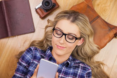 Gorgeous smiling blonde hipster using smartphone Stock Photos