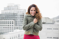 Gorgeous smiling brunette in winter fashion looking at camera Royalty Free Stock Photography