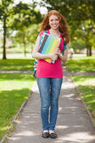 Gorgeous smiling student carrying notebooks Royalty Free Stock Images
