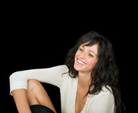 Gorgeous smiling woman on a black background. Royalty Free Stock Image