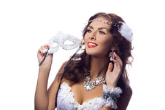 Gorgeous smiling woman in masquerade mask Stock Image