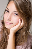Gorgeous smiling young brunette girl. Royalty Free Stock Photography