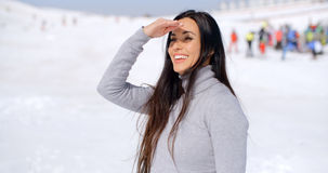 Gorgeous smiling young woman at a ski resort Stock Photo