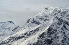Gorgeous Snowy Mountain Peak of Himalayas in a Dim Evening Light Royalty Free Stock Image
