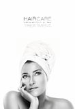 Gorgeous Spa woman with a pensive expression. Haircare concept Stock Images