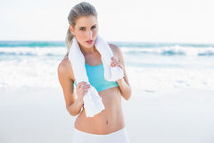 Gorgeous sporty blonde in sportswear with towel around neck Royalty Free Stock Image