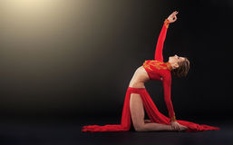 Gorgeous sporty woman in red clothing doing yoga exercise Royalty Free Stock Photo