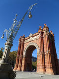 Gorgeous street lamp and stunning Triumphal Arch of Barcelona. Spain Royalty Free Stock Photos