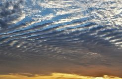 GORGEOUS STRIATED CLOUD FORMATION. STRATOCUMULUS UNDULATUS, FILLS UP THE SKY WITH BLUE AND ORANGE HUES. GORGEOUS FLORIDA SKY SHOWING STRIATED CLOUD FORMATION royalty free stock images