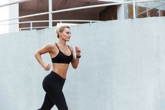 Gorgeous strong young sports woman running stock photos