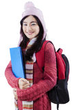 Gorgeous student wearing winter clothes in studio Royalty Free Stock Photos